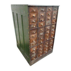 """Pre-owned 1920s Industrial Wood Case 48 Metal Drawer Cabinet - A killer 1920s industrial wood cabinet. This vintage factory relic features mission style slat board sides, fantastic naturally distressed alligator green paint, bull nose front, and 48 faux wood grain metal drawers (some with old wood dividers). This piece has great signs of an Industrial factory past with great patina. This piece would be great for a Steampunk loft,  designer clothing store or artist. There has been recent painting to the two panels in the back.    Each drawer measure 4.5"""" wide x 2.5"""" tall x 25"""" deep."""