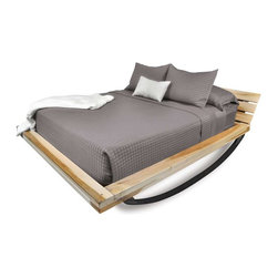 Shiner - Shiner Flex Bed, Queen, Natural - Modern, eco-friendly furnishings made in Atlanta, Georgia. Our goal is to transform tons of landfill-destined materials into killer designs. By building pieces out of disposable elements, we refine the future by upcycling the past. Everything from the steel, hardwoods, and cardboard to our lexan and linen is diverted from the incinerator. We strive to make every piece knock-down for ease of shipping with less environmental impact. The Flex Bed, available in Ebony or Natural, features a spring-like base, producing a 360 degree rocking motion.