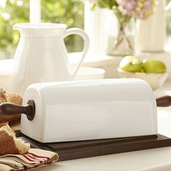 """Rhodes Ceramic Rolling Pin Bread Box - Store fresh, artisanal bread from the bakery or your favorite homemade loaf in this unique bread box. 18.75"""" long x 7.5"""" wide x 6"""" high Cover made of stoneware with a glazed finish. Base and handles made of vertebra wood. Catalog / Internet only."""