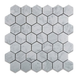 White Carrara Hexagon Marble Honed Mosaic Tiles - Carrara is classy and timeless. The hexagon shape gives this a much more modern/edgy look.