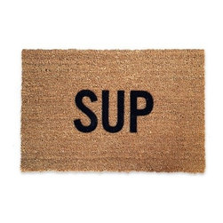 "Sup Doormat - Guests start arriving greeted by a doormat that sets the tone...SUP?!  Shake hands and bro hug, nod to the ladies, handing out directions to the bar...downstairs then hang a left, help yourselves. Traditionally a mat is monogrammed with the homeowners last name, though can you really describe yourself any better? Casual, welcoming, a hint of slang...saying relax, chill, good times await inside, no enemies here.  Made of coir and vinyl, sized 30"" x 20"" in good ole Merica.  Peace."