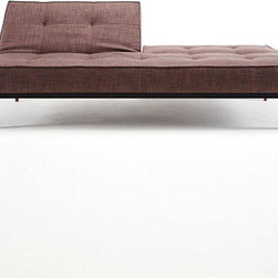 Divi Sofa in Brown - Multifunctional and completely modern, the Divi Sofa is a study in playfulness and simple, modern design. Convertible to a full-sized bed, the sofa has a 7-inch thick mattress, powder-coated metal frame, and walnut wood legs. Perfect for living rooms and guest rooms that need a hard-wearing, sophisticated, and versatile piece of furniture that's good for entertaining and for sleeping.