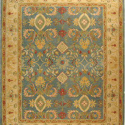 Handmade Legacy Hand-Spun Wool Rug - The shades of tobacco paired with grayish-blue are divine in this rug. It would be a show-stopper in a warm, wood-paneled study with well-worn leather chairs. Bonus points if a glass of port and cigar are involved.