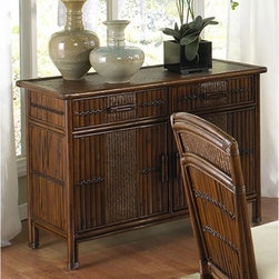 Hospitality Rattan - Hospitality Rattan Polynesian Indoor Rattan & Wicker Buffet with Glass Top - Ant - Shop for Buffets and Side Boards from Hayneedle.com! You're not going to be one of those people who are all style and no substance so you'll appreciate the Hospitality Rattan Polynesian Indoor Rattan & Wicker Buffet with Glass Top - Antique. The tropical style can't be ignored thanks to the tri of rattan bamboo and wicker that compose the body of this buffet. Two pull-out drawers sit above a central storage compartment and the antique finish gives the whole piece a traditional feel.About Hospitality Rattan Hospitality Rattan has been a leading manufacturer and distributor of contract quality rattan wicker and bamboo furnishings since 2000. The company's product lines have become dominant in the Casual Rattan Wicker and Outdoor Markets because of their quality construction variety and attractive design. Designed for buyers who appreciate upscale furniture with a tropical feel Hospitality Rattan offers a range of indoor and outdoor collections featuring all-aluminum frames woven with Viro or Rehau synthetic wicker fiber that will not fade or crack when subjected to the elements. Hospitality Rattan furniture is manufactured to hospitality specifications and quality standards which exceed the standards for residential use. Hospitality Rattan's Environmental Commitment Hospitality Rattan is continually looking for ways to limit their impact on the environment and is always trying to use the most environmentally friendly manufacturing techniques and materials possible. The company manufactures the highest quality furniture following sound and responsible environmental policies with minimal impact on natural resources. Hospitality Rattan is also committed to achieving environmental best practices throughout its activity whenever this is practical and takes responsibility for the development and implementation of environmental best practices throughout all operations. Hos