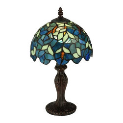 Meyda Tiffany - Nightfall Wisteria Mini Table Lamp - Requires one 40 watt candelabra type bulb. Floral nouveau style. Unique and handcrafted. Has deepening blooms and climbing vines of wisteria shrubbery. Made from copper foil. Shade in blue and green color. Shade: 8.25 in. Dia. x 5 in. H. Overall: 8.25 in. Dia. x 14 in. H. Care InstructionsNatural variations, in the wide array of materials that use to create each product, make every item a masterpiece of its own. Capture the tranquility of a garden stroll at nightfall with this mini lamp. Tiffany in the early 20th century is a masterpiece to be proudly displayed and privately enjoyed in any home or interior setting.