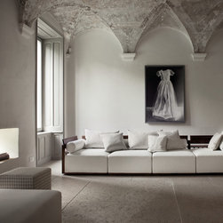 Porada Wood Furnishings - The Bolero sofa by Porada is a modular sofa system with frame in solid canaletta walnut and removable cover available in fabric, leather, or eco-pelle.