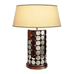 Merv Lamp - There's just the right bit of disco to this reflective and intricate table lamp.