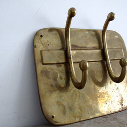 Vintage Metal Brass Hooks by Snapshot Vintage - It is always useful to have a few wall hooks on hand for hanging up guests' coats or bags, especially if you have an outside entrance to your home office. This vintage brass coat hook has loads of character.