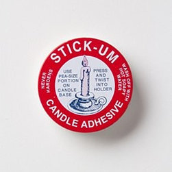 Anthropologie - Stick-Um Candle Adhesive - This wax-based, innovative formula developed by Fox Run keeps candlesticks in place with nary a tilt. Simply place a pea-sized portion into the base, press and twist the taper in.Wax, oil0.5 ozUSA