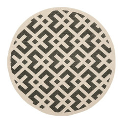 Safavieh - Poolside Black/ Bone Indoor Outdoor Rug (6'7 Round) - This stylish round indoor-outdoor rug features a trendy bone background with black design elements. The size is perfect for lounging poolside outdoors or relaxing inside. The polypropylene material ensures that mold and mildew are kept at bay.