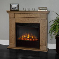 Real Flame - Real Flame Lowry Slim Line Electric Fireplace - Blonde Oak Multicolor - 7990E-BL - Shop for Fire Places Wood Stoves and Hardware from Hayneedle.com! This Real FlameLowry Slim Line Electric Fireplace - Blonde Oak turns any house into a home. This compact electric fireplace glows with a strikingly realistic fire. It also cranks out the heat with an adjustable 1400 watt heater. The brightness heat and timing are all fully adjustable. This electric fireplace also includes a helpful remote control so you never have to get out of your blanket.About Real FlameReal Flame is the original premium gel fuel designed for use with ventless gel fireplaces and accessories. For more than 25 years Real Flame has been the leading alcohol-based gel fuel on the market. Real Flame gel is an environmentally friendly non-toxic clean-burning gel that doesn't leave any soot smoke or ashes behind - so there's no messy cleanup. Best of all Real Flame creates a robust bright yellow orange and red flame that crackles just like a log fire. Made in the U.S.A.Real Flame is made from pure premium-grade isopropyl alcohol and thickeners to enhance stability. Real Flame is the safest most viscous (thick) gel fuel available on the market. It is not liquid and will not break down separate or liquefy as quickly as other brands. To maintain the integrity and stability of Real Flame all Real Flame gel cans are specially treated to prevent rusting on the inside. Environmentally FriendlyReal Flame is a safe clean-burning gel that is regularly tested by numerous independent labs. Air-quality results while burning Real Flame gel fuel fall well below the standards established by the Occupational Safety and Health Administration (O.S.H.A.) and the Environmental Protection Agency (E.P.A.). Each batch of Real Flame gel fuel production is closely monitored to ensure the highest quality. EfficiencyEach can of Real Flame gel fuel is designed to burn for up to 2.5 to 3 hours. If you wish to create a fire for a shorter period simply extinguish the flame and re-cap the can. Reuse any remaining gel fuel for your next fire. For each fire you may use one to three cans of gel fuel at a time depending on the size of fire you wish to create. When compared to cartridge-style cans one can of Real Flame gel fuel is available at a fraction of the cost. Growing PopularityMillions of consumers can't be wrong. Loyal customers have made Real Flame the leading gel fuel on market today. Don't be fooled by unscientific consumer polls. Real Flame is the original and best-selling gel fuel available and has been on the market the longest. Never settle for any other gel fuel in your Real Flame fireplace or accessories.