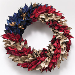 Americana Wreath - I think this wreath made out of seed pods is absolutely beautiful. My front door is painted a vibrant blue, and I'd love to hang these more muted hues against it.