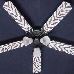 Ceiling Fan Designers African Safari Zebra Skin Indoor Ceiling Fan - Take your room for a walk on the wild side with the Ceiling Fan Designers African Safari Zebra Skin Indoor Ceiling Fan. With its black and white zebra pattern, this fun ceiling fan cools down and lights up your room in high style. Well-made and stylish, this fan and light combo comes in your choice of size: 42-inch with 4 blades or 52-inch with 5. The blades are reversible so you get the colorful design on one side and white on the other. It has a powerful yet quiet 120-volt, 3-speed motor with easy switch for year-round comfort. The 42-inch fan includes a schoolhouse-style white glass shade and requires one 60-watt candelabra bulb (not included). The 52-inch fan has three alabaster glass shades and requires three 60-watt candelabra bulbs (included). Your ceiling fan includes a 15- to 30-year manufacturer's warranty (based on size).