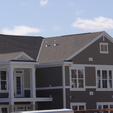 Traditional Exterior by Smardbuild Construction Inc.