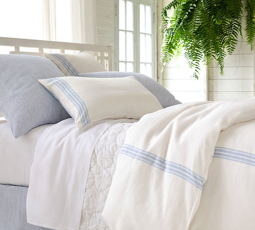 Varana Linen French Blue Duvet Cover - It would be well-suited as much to a French country home in Provence as to a bungalow in Bel Air; such is the refined beauty of the Varana Linen French Blue Duvet Cover. The pale background and colored striping allow the piece to blend easily with a room decor of muted colors or to soften the presentation of more vibrant hues.