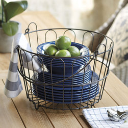 Ballard Designs - Farmers Market Basket - Great for sewing materials. Fill with colorful balls for the holidays. Fill this versatile basket with dry goods in the kitchen, magazines in the family or rolled towels in the bath. Modeled after a farmer's egg basket, it's hand crafted of iron with sturdy welded joints and bronze finish. Drop handle makes it easy to carry. Farmers Market Basket features: . .
