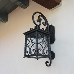 Exterior Iron Lights - Classic and elegant design in this exterior hand forged iron lantern with 1 light. Clear seeded glass, powder coat base and an additional hand applied color finish for that Old World look are elements that are always included in our exterior pieces.