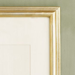 "PB Gilt Picture Frame, 5 x 7"" Medium Frame, Champagne Gilt finish - Beautiful frames like these are the touches that give your room a polished look. Crafted of pine wood. Washed in rich champagne gilt. Available in 3 sizes in medium or wide frame. Bevel-cut, archival-quality ivory mat is included with the large and x-large frames. Designed to display vertically or horizontally on a tabletop or to mount to a wall; mounting hardware is included. Watch a video about creating a {{link path='/stylehouse/videos/videos/dt_v4_rel.html?cm_sp=Video_PIP-_-DESIGN_TIPS-_-NEW_FAMILY_WALL' class='popup' width='950' height='300'}}family photo gallery{{/link}}."