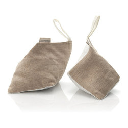Frontgate - Linen Shoe Inserts - Offered in a set of 2. Ivory/Natural linen bags filled with Lavender or Cedar. Great gift idea for men and women. Perfect for storage or travel, each pair of shoes should have our Linen Shoe Inserts. Help deodorize and retain the shape of your footwear with each elegantly shaped, fresh smelling pouch.  . .  . Made in the USA.