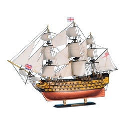 "Handcrafted Model Ships - HMS Victory Limited 21"" - Wooden Tall Ship Model - Sold fully assembled. Ready for Immediate Display - Not a model ship kit.. . The HMS  victory limited 21"" is a 104 gun first rate ship of the line tall ship. Although this tall warship was used in multiple battles, it is still in commission and she holds the title of oldest commissioned warship in the world. This is the ideal gift for those looking to display a ship rich with naval history and intricate details to display on a desk or shelf. 21"" Long x 6"" Wide x 13"" High (1:130 scale)"