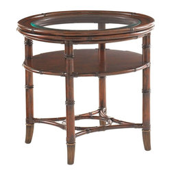 Lexington - Tommy Bahama Home Landara Maricopa Round Lamp Table - With a sophisticated mix of materials, this piece features carved rattan-trimmed wood, gracefully framing the beveled glass top. Below the top, the wood shelf and rattan stretcher are accented with leather strapping throughout and antique brass finished ferrules adorning the bottom.