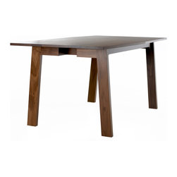 """Commonhouse - Canted Table - Canted Table  by Commonhouse Furniture The Commonhouse Canted Table is an elegantly minimal piece you can be proud to host guests at for dinner. The table top is slightly angled for a more intimate setting while the angled legs provide plenty of support while giving you enough room to comfortably fit 6 people. Constructed of solid wood, the Canted Table from Commonhouse Furniture combines the brilliance of Amish and Mennonite woodworking with a minimal, modern design for a piece that is a welcome addition to any home.   The Canted Table features: 68"""" w x 36"""" d x 29.5"""" h Solid wood construction, available in 4 finishes Comfortably sits 6 Slight angular top shape Angled legs"""