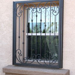 Tuscan Window Guards by First Impression Security Doors - First Impression Security Doors custom makes beautiful window guards.