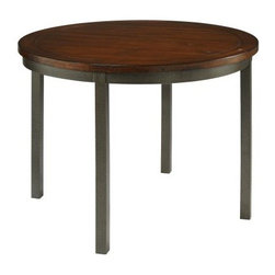 Home Styles Cabin Creek Round Dining Table - Rustic style comes home with the Home Styles Cabin Creek Round Dining Table. This table is hand-distressed to look like a treasured antique shop find. It's well-crafted with a hammered metal frame and mahogany solids and veneers top in a weathered chestnut finish. Its round shape accommodates four beautifully.About Home StylesHome Styles is a manufacturer and distributor of RTA (ready to assemble) furniture perfectly suited to today's lifestyles. Blending attractive design with modern functionality, their furniture collections span many styles from timeless traditional to cutting-edge contemporary. The great difference between Home Styles and many other RTA furniture manufacturers is that Home Styles pieces feature hardwood construction and quality hardware that stand up to years of use. When shopping for convenient, durable items for the home, look to Home Styles. You'll appreciate the value.