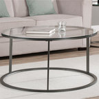None - Round Glass Top Metal Coffee Table - This round-glass-top coffee table looks great in any living room or recreation room setting. Its tempered-glass top and sturdy metal frame hold up to repeated use, and its frame is coated with a scratch-resistant finish for additional protection.