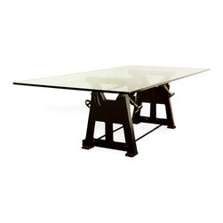 Kathy Kuo Home - Bartley Industrial Reclaimed Cast Iron Glass Dining Table - Small - Crafted from tempered glass featuring a reclaimed cast iron base, this dining table is a true statement piece that would be the perfect addition to a wide open loft space. Born from industrial machine parts, you'll seat up to eight at this dinner-party ready table. Enjoy a one year warranty on this piece.