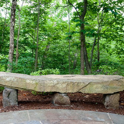Impressions - Custom stone bench in the woodland garden by Rock Spring Design Group