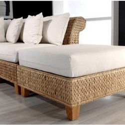 "Hospitality Rattan Seagrass Ottoman with Cushion - Natural - By itself or as part of a full sectional built around the Hospitality Rattan Seagrass line, the Hospitality Rattan Seagrass Ottoman with Cushion - Natural is a piece that will never fail to add life and comfort to any space. A wooden frame is the base that is covered with woven seagrass and supported by solid teak legs with a natural finish. The square-bound cushion on the top provides comfort and support, and the neutral fabric will work in any space.About Hospitality RattanHospitality Rattan has been a leading manufacturer and distributor of contract quality rattan, wicker, and bamboo furnishings since 2000. The company's product lines have become dominant in the Casual Rattan, Wicker, and Outdoor Markets because of their quality construction, variety, and attractive design. Designed for buyers who appreciate upscale furniture with a tropical feel, Hospitality Rattan offers a range of indoor and outdoor collections featuring all-aluminum frames woven with Viro or Rehau synthetic wicker fiber that will not fade or crack when subjected to the elements. Hospitality Rattan furniture is manufactured to hospitality specifications and quality standards, which exceed the standards for residential use.Hospitality Rattan's Environmental CommitmentHospitality Rattan is continually looking for ways to limit their impact on the environment and is always trying to use the most environmentally friendly manufacturing techniques and materials possible. The company manufactures the highest quality furniture following sound and responsible environmental policies, with minimal impact on natural resources. Hospitality Rattan is also committed to achieving environmental best practices throughout its activity whenever this is practical and takes responsibility for the development and implementation of environmental best practices throughout all operations. Hospitality Rattan maintains a policy of continuous environmental improvement and therefore is a continuing work in progress.Hospitality Rattan's Environmentally Friendly Manufacturing ProcessAll of Hospitality Rattan products are green. From its basic raw materials of rattan poles, peels, leather, bamboo, abaca, lampacanay, wood, leather strips, and boards, down to other materials like nails, staples, water-based adhesives, finishes, stains, glazes and packing materials, all have minimum impact to the environment and are safe, biodegradable, recycled, and mostly recyclable. Aside from this, the products have undergone an environmentally-friendly process that makes them """"greener."""" The company's rattan components are sourced from sustained-yield managed forests, which means the methods used to grow and harvest the rattan vines ensure the long-term life of the forest and protect the biodiversity of the forest's ecosystems.Hospitality Rattan is committed to buying and using all materials, from rattan and hardwood to finishing materials, from reputable and renewable suppliers and seeks appropriate evidence that suppliers are in compliance with this policy. Hospitality Rattan strives to use materials that are processed in an environmentally responsible manner, or consist of a high level of recycled material. Finishing materials and stains used in Hospitality Rattan's furniture products consist of 75% water-based solutions which evaporate upon application with reduced or Volatile Organic Compounds (VOCs). The furniture factories use water-based glues, stains, topcoats and other finishes on all of their products. The switch from traditional solvent-based processes to water-based processes involved consolidating several processes by the factories, resulting in an 85% reduction in VOC emissions."