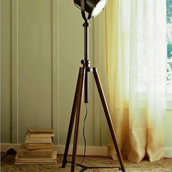 Photographer's Tripod Floor Lamp - I love, love, love industrial movie-inspired floor lamps! I know these are everywhere, but I really like the shape of this lamp.