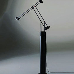 Artemide - Tizio Plus with Floor Lamp Support - This Tizio Plus Table Lamp with Floor Support features a floor support in lacquered steel with snap in adapter kit in molded thermoplastic.  Tizio Plus features parallel and transversal head rotation.  Incorporated dimmer and low voltage transformer. Finish for lamp with floor support available in Black only.  Floor support is 27 9/16 inches high x 4 5/16 inch diameter.  Tizio Plus lamp is 26 inches high x 30.75 inches deep x 46 7/8 inch maximum arm extension.  Tizio Plus lamp includes one 50 watt GY6.35 halogen lamp.  UL listed.