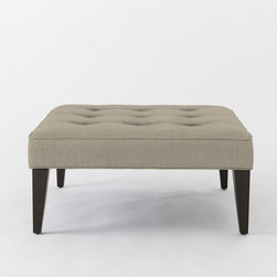 Upholstered Tufted Ottoman, Natural Linen Weave - I don't use coffee tables in my home. But because I so love to put my feet up, I opt for a linen-covered ottoman.