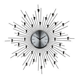 LexMod - Silver Starburst Wall Clock (Retro Modern) - Distinct spheres of influence form a constellation of meaning in this retro modern work. Charged metal silver-toned rays meet planet-like objects on the pathway toward outer worlds. Full of expression and vitality, the Starburst clock is a distinct piece for any emblematic home.