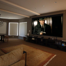 Eclectic Home Theater by Mahoney Architects & Interiors