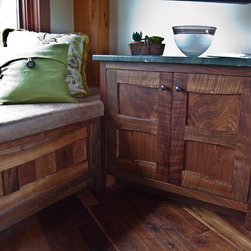 Custom Claro Walnut Bench and Cabinet - Claro Walnut offers swirling grain patterns and rich brown tones. This custom bench and cabinet offer storage and seating space in a timber frame guest house. (Timber frame by New Energy Works Timberframers)