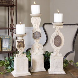 "Uttermost - Tibon Candleholders - Set of 3 - Carved Wood In A Natural Tone Accented With Metal Medallions. White 3x3 Candles Included. Sizes: Sm-5x12x4, Med-5x16x4, Lg-5x19x4. Uttermost's Accessories Combine Premium Quality Materials With Unique High-style Design. Overall Dimensions: 4.25""D x 5.25""W x 19""H"