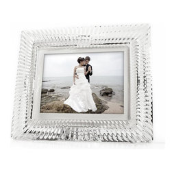 Trademark Global - Waterford Crystal 8 in. Somerset Digital Phot - Authentic Waterford Crystal Digital Photo Frame. White Mat. AC Adapter. User Guide. Remote Control. High Resolution Display. Digital greeting lets you add a customizable message to one of four included designs. Integrated Memory stores up to 1600 photos. Clock and Calendar view features your photo slideshow. Supports JPG, AVI and MP3 Files. Built-in Memory Card Reader. Programmable On/Off. 800x600 Resolution. 10.5  in. W x 3.5  in. D x 9 in. HDesigner Luxury and Technology Finally Meet. For the first time, the worlds premium crystal frame brand is available as a digital photo frame, allowing you to store hundreds of photos in one simple step on one beautiful Waterford crystal photo frame. the perfect unique gift for any eventweddings, anniversary, birthdays, Mothers Day, Christmasor simply add a stunning new element to your home decor.