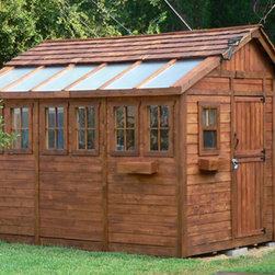 Outdoor Living Today - Outdoor Living Today SSGS812 Sunshed 8 x 12 ft. Garden Shed - SSGS812 - Shop for Sheds and Storage from Hayneedle.com! The Outdoor Living Today SSGS812 Sunshed 8 x 12 ft. Garden Shed is a perfect choice for the serious gardener. This beautiful greenhouse structure is constructed from durable western red cedar. It features a handy workbench and lets in plenty of natural light with the two functional screen windows and the four fixed side windows. Any green thumb can appreciate features like the lexan polycarbonate roof windows a 31-inch Dutch-style door on the side of the shed and a mahogany veneer on the interior panels. Assembly is a weekend project for one or two people. One-year limited warranty included.DimensionsExterior: 11.5W x 8.2D x 9.3H feetInterior: 10.9W x 7.6D x 9.1H feetDoor: 2.6W x 6H feet About Cedar WoodCedar wood is lightweight and resistant to both cracking and moisture rot. The oils of this resilient wood guard against insect attack and decay and their distinctive aroma acts as a mild insect repellant. Cedar is a dependable choice for outdoor furniture either as a finished or unfinished wood. Over time unfinished cedar left outdoors will weather to a silvery gray patina. This natural process does not compromise the strength or integrity of the wood.Another great aspect of cedar is its environmental effect - which is minimal. A renewable resource cedar wood emits low greenhouse gases. So rest assured knowing that your beautiful cedar furniture is a green choice too!About Outdoor Living TodayOutdoor Living Today has a simple goal. That goal is to provide the best wood products to the marketplace at the best value. Established in 1974 Outdoor Living Today has a well-earned reputation for making products that are functional durable attractive and affordable. Products are designed so that the average person with limited building skills can assemble them. Gazebos sheds playhouses and pergolas are all uniquely designed and constructed from beautiful Western red cedar.