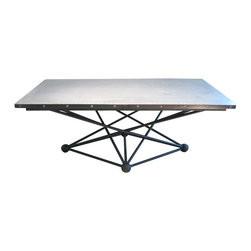 R.T. Facts - Black Atom Table Base - Supercharge your dining room! This striking table base will have you discussing science over supper. Inspired by the wondrous atom, there is nothing small — and nothing negative — about this impressive-looking support.