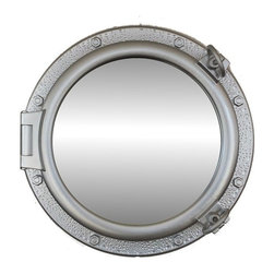 Handcrafted Nautical Decor - Silver Porthole Window 20'' - This Silver Porthole Window 20'' adds sophistication, style, and        charm for those looking to enhance rooms with a nautical theme. This        boat porthole has a sturdy, heavy and authentic appearance, yet it  is       made of wood and fiberglass to lower the weight for use as   nautical    wall   decor. This porthole window makes a fabulous style   statement  in   any   room with its classic round frame, eight solid   rivets and two  dog    ears  surround the perimeter of the porthole   frame.--NOTE: This is a decorative porthole window (the    center is clear glass and not an ocean scene). However, any image (such    as the ocean scene pictured) can easily be put in the center of the    porthole for either our porthole windows or mirrors.--Dimensions: 20'' L x 2'W x 20'H----    Functional porthole window holds clear glass which can be removed at any time--    Handcrafted and hand-painted a silver finish by our master artisans--    Realistic nautical decor - modeled after an antique 19th-century ship's porthole--    --    Great porthole wall decor and an instant conversation piece----