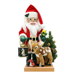 """Frontgate - Christian Ulbricht Santa and Deer Nutcracker - Exquisite detail in an 18"""" tall figurine. Each nutcracker is handcarved and hand-painted, with careful attention to detail. Handcrafted from the finest wood and materials. The Santa and Deer Nutcracker from Alexander Taron shows Santa is ready for takeoff on Christmas Eve. With his lantern in hand and one of many reindeer by his side, Kris Kringle just needs his sleigh. You'll enjoy the intricacies and master craftsmanship of Christian Ulbricht figurines, a holiday tradition since 1928.  .  .  . Made in Germany."""