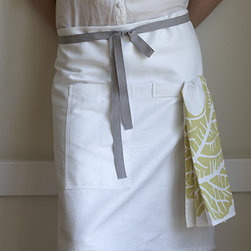 Café Apron, Oyster - One of the things I love about design is how the addition of a gray tie on this basic white apron can make it so memorable.