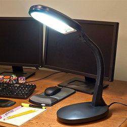 "Trademark Home Collection - Deluxe Black Sunlight Desk Lamp - Colors appear more vivid and true to life. Black and white contrast is heightened for easier reading. The soft and pure white light is easy on the eyes as it spreads to clearly illuminate your personal space. The flexible goose neck is fully adjustable to any angle. Helps reduce eye strains. The supplied high-tech 27-watt bulb, with a C.R.I.(Color Rendering Index) of 80-85, gives as much light as an ordinary 150-watt bulb, but uses far less energy. Bulb gives off 1300 LUMENS. Kelvin temperature is 6500K. 7 in. L x 9 in. W x 22 in. H (5 lbs.)Are you ready to have a sunny day, Every day? With the Trademark Home Sunlight lamp you can get that Inside! So much like sunshine it feels like you're on vacation! The Trademark Home Sunlight lamp could be the most important advance in lamps since the invention of the light bulb! The New lighting technology simulates outdoor sunlight, which is balanced across the entire spectrum of color visible to the human eye. Everything seems so much easier to see. Sharp visibility for more detail. Glare free for computer use. What does the Trademark Home Lamp look like? It stands 60.5 inches and is off white in color. The Sunlight Lamp will look good in any room in the house or in the office. Why is the Bulb better than normal bulbs? Savemoney on your electric bills! . The bulb can last up to 5000 hours, 5x longer than other bulbs- for years of normal use. We've nicknamed our Sunlight Lamp the ""It's great to be alive lamp""! Many people say that bright sunny days seem to have a cheerful and energizing effect, but that dreary, dark days make them feel ""blue"". Now you can switch on the sunlight, indoors, everyday of the year!"