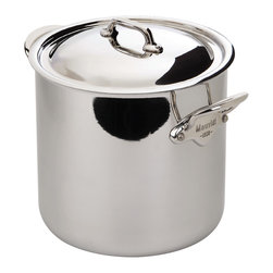 Mauviel M'cook 3.0 qt. Magnetic Stock Pot with Lid - The Mauviel M'cook 3.0 qt. Magnetic Stock Pot with Lid offers professionals and household cooks the highest culinary technology.  Five layers of materials provide perfect conductivity for each product  thanks to fast and uniform heat distribution. The handles are made from cast stainless steel  and reinforce the pure and modern design of this range.  Each piece of Mauviel cookware is handcrafted in France.   Product Features      5 ply Construction - High performance cookware  works on all cooking surfaces  including induction   2.6 mm Thickness on all shapes - even heat distribution (fast  uniform  controlled cooking)   Pouring rims on all shapes - eliminates drips when pouring liquids   Handles fixed by sturdy stainless steel rivets   Oversized  cast stainless steel handles - for safe lifting of stew pans  roasters and other large pots.   Professional diameters and heights - M'Cook products have high sides and are designed for both professional and household cooking   Oven safe to 680° F   Dishwasher safe.   Each piece handcrafted in France by Mauviel - manufacturing cookware since 1830   Lifetime guarantee. (Warranty not valid for commercial use)