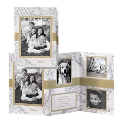 """Exposures - Flourishing Scrolls Collage Card Set of 20 - Overview Decorative flourishing scrolls cascade across the pearlized cardstock of this elegant collage card. Choose from 2 colors to coordinate with 4 of your special holiday photos - stylish silver with gold, or a merry red with gold. Add up to 5 lines of custom personalization on the middle panel. With all your card personalization included, sending customized holiday greetings is easier than ever!  Features:  Upload, edit and preview your photos and personalization in our online design tool Specialty pearlized card stock Set of 20 photo cards Includes 20 ivory envelopes Includes 20 coordinating gold foil-lined ivory envelopes Includes foil envelope seals to add a special finishing touch  Personalization  All card personalization is included, up to 5 lines of personalized text, 35 characters per line.  Envelope personalization available in black and is imprinted on the back flap of the envelope. Up to 3 lines, 45 characters per line Standard artwork: """"2013"""" No returns on personalized items unless the item is damaged or defective   Specifications  Order online only Requires 4 photos This design works best with 2 vertical format (portrait) photos and 2 horizontal format (landscape) photos Z-fold, accordion-style card Folded card size: 5"""" wide x 7"""" high   Shipping  Please allow an additional 2-3 weeks delivery No returns on personalized items unless the item is damaged or defective We cannot deliver to a PO Box delivery address for this item"""