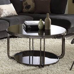 Tribecca Home - TRIBECCA HOME Edison Black Nickel Plated Castered Modern Round Coffee Table - Add contemporary flair and reflect light in your living room with this modern round coffee table from Edison. This stunning showpiece features black nickel-finished chrome paired with tempered glass for a look that is a safe as it is modern.