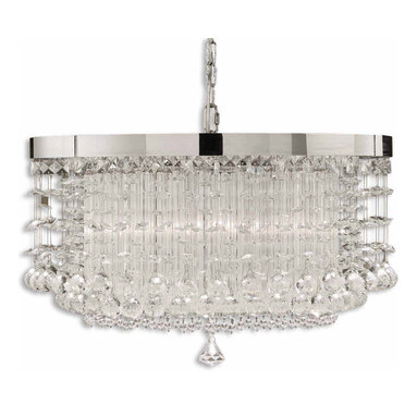 Fascination 3 Light Chandelier by Uttermost - Fascination 3 light chandelier features the classic appeal of crystal, updated for today's sophisticated tastes. Chrome plated rim adorned by various styles of crystal accents. Also available in hanging shade, pendant, wall sconce, and table lamp versions. Requires (3) 75 watt, 120 volt, medium base incandescent bulbs not included. 21W x 14H.